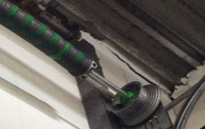 Broken Torsion spring garage door Syracuse